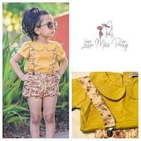 girl wearing yellow polo shirt with multi colored floral print jumper Mogadore, 44260