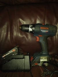 green and black Bosch cordless hand drill 534 km