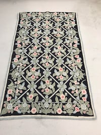 Handmade chain-stitched wool rug
