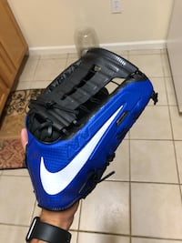 Black and blue nike baseball mitt Clearwater, 33765