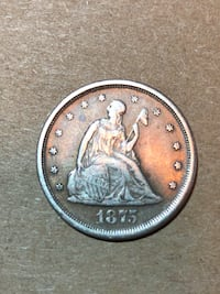 1875 woman embossed coin