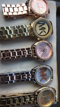 three round silver-colored analog watches 230 mi