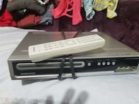 gray and black Magnavox DVD player with remote con