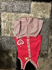 red and white striped polo shirt and black shorts Hampstead, H3X 1G7
