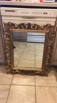 "Mirror, 28"" long w24""wider 23 mi"