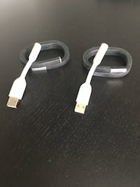 2 Jawbone step and sleep trackers, with chargers