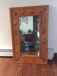Heavy wood framed mirror with leather boot decals