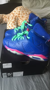 purple-and-pink Air Jordan 6's with box