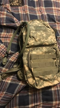 white and green camouflage Camelbak backpack 1233 mi
