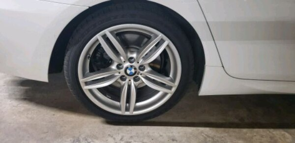 BMW wheels and like new run flat tires for sale