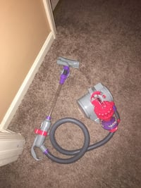 Blue and red vacuum cleaner toys