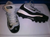 pair of white-and-black Nike cleats