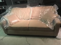 "Tan brand new still in factory sealed 80"" sofa"