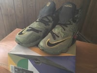 pair of gray-and-black Nike basketball shoes with box Islip, 11722