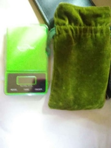 green digital weighing scale with drawstring bag