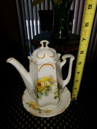 white and yellow floral ceramic pitcher