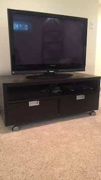 black flat screen TV with black wooden TV stand Fairfield, 06824