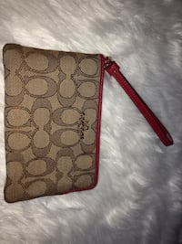 Red and brown coach wristlet brand new! Toronto, M1G 2R1