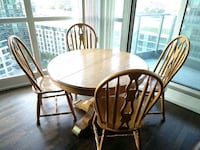 round brown wooden table with four chairs dining set Toronto, M5V 4A2