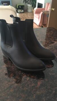 Brand New Urban outfitters pair of black leather boots