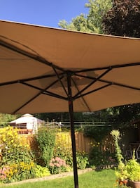 7.5 foot tan patio umbrellas,new in carrying bag. Please call phil  [PHONE NUMBER HIDDEN]  .brampton area .