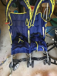 baby's blue and yellow twin stroller
