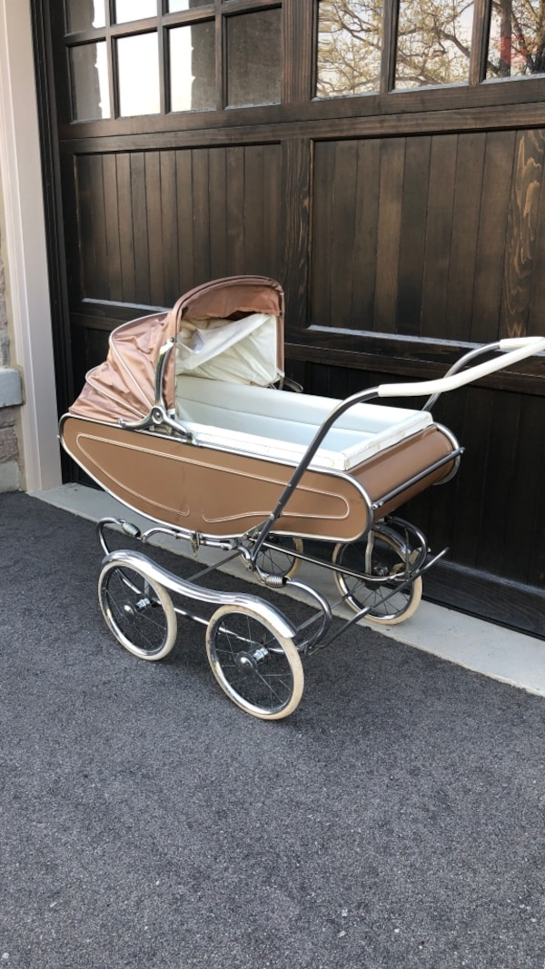 Baby's brown and white bassinet stroller