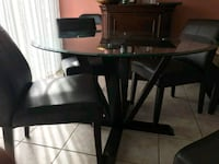 4 leather chairs, tempered glass dining set 550 km