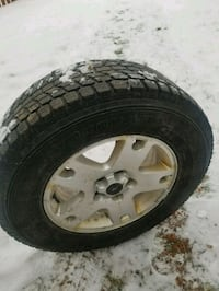 silver 5-spoke vehicle wheel and tire Laval, H7M 1V1