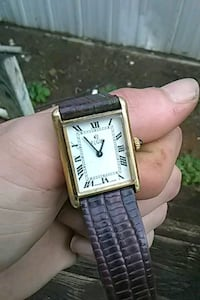 square silver-colored analog watch with link brace 358 mi