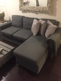 Dark grey sectional sofa, just few month old. Moving and must be picked up before Dec 1st   556 km