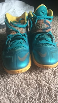 Pair of teal-and-yellow Lebron James basketball shoes size 8 Ballwin, 63011