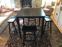 All black table with four stool type chairs. Great Condition High Point, 27262