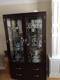 Brown wooden framed glass display cabinets ****moving sale ***^^ Laval, H7X 4G4