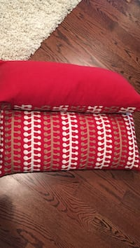 Two red throw pillows brand new