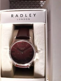 round silver analog watch with black leather strap SLOUGH
