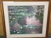 rectangular brown wooden framed painting of water lillies