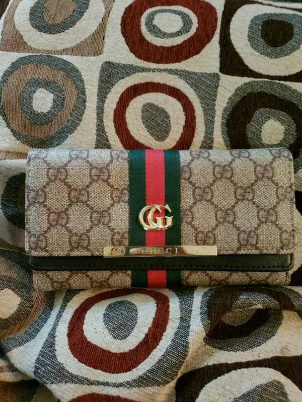 brown and black Gucci wallet