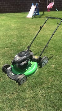 green and black push mower Rogers, 72758