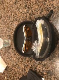 orange tint sunglasses with white plastic frame and case