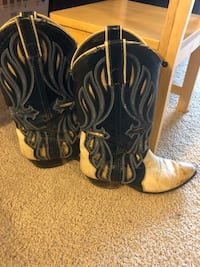 pair of black-and-brown leather cowboy boots