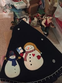 Christmas Tree Skirt, Navy with Embroidered Stars and Appliqué Snow People with White Trim. Like new. Suitable for large tree. Edges come together with Velcro tabs. High quality. Saint Louis, 63129