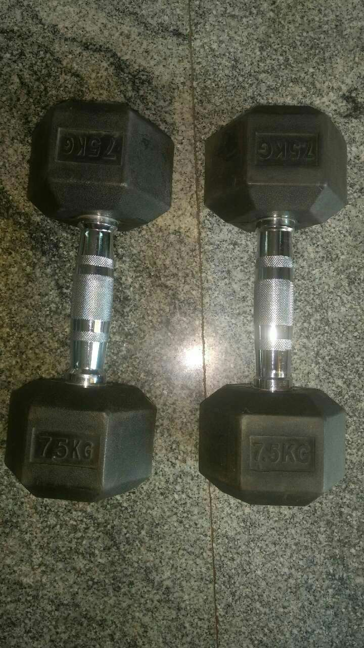 two black fixed weight dumbbells