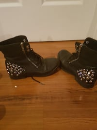 pair of studded black lace-up ankle boots