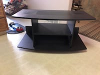 black wooden 3-layer TV stand null
