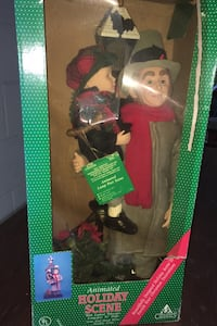 Bob cratchit tiny Tim new never used in box.. moves lights up