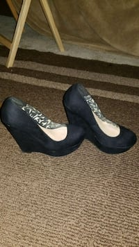 pair of women's black suede wedge shoes Odenton