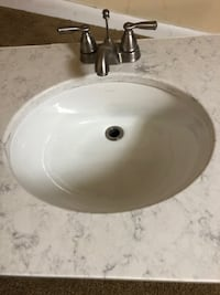 Quartz countertop with faucet and kohler bowl