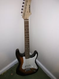 brown and white stratocaster electric guitar Augusta