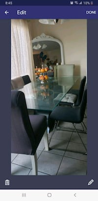Modren glass dining table with geometric base n 4grey chairs
